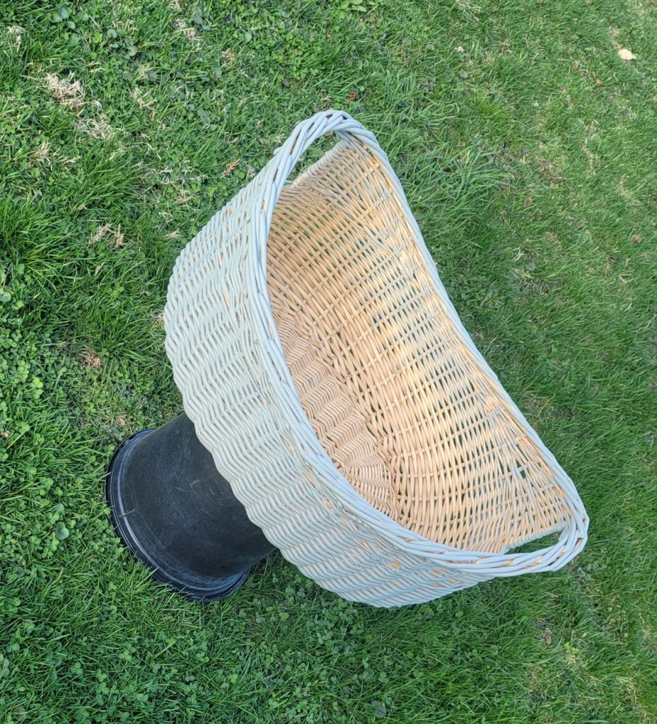 spray painting the nice oval basket as the pet bed