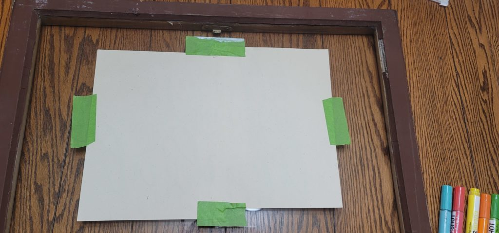 tape template to back of sign for easy DIY sign using ColorShot paint pen