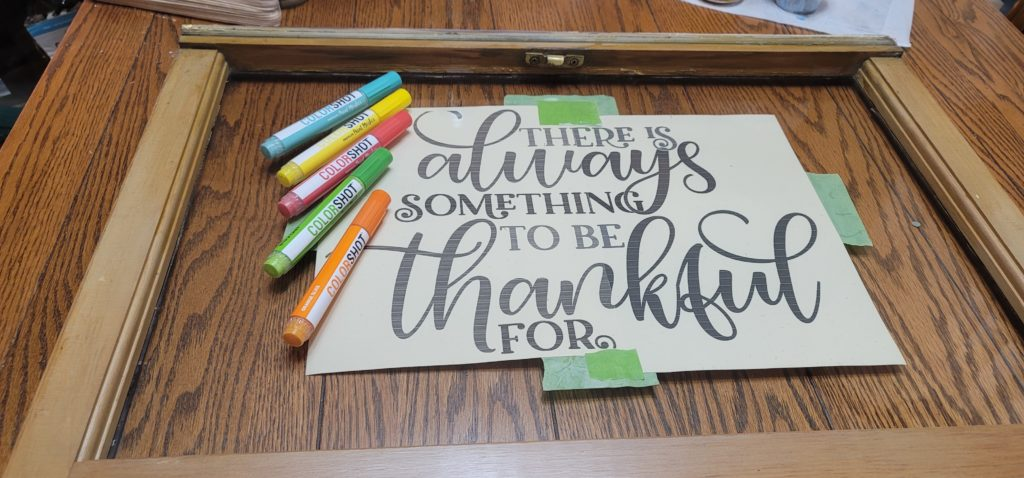 Easy DIY sign with ColorShot Paint Pens and reclaimed window