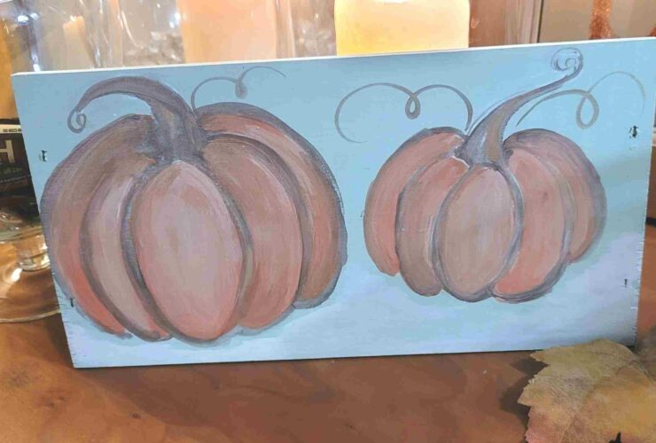 35 finished pumpkins painted on wood